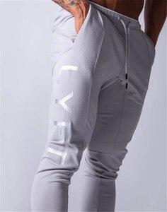 Image 5 - 2020 New Jogging Men Sport Sweatpants Running Pants GYM Pants Men Joggers Cotton Trackpants Slim Fit Pants Bodybuilding Trouser