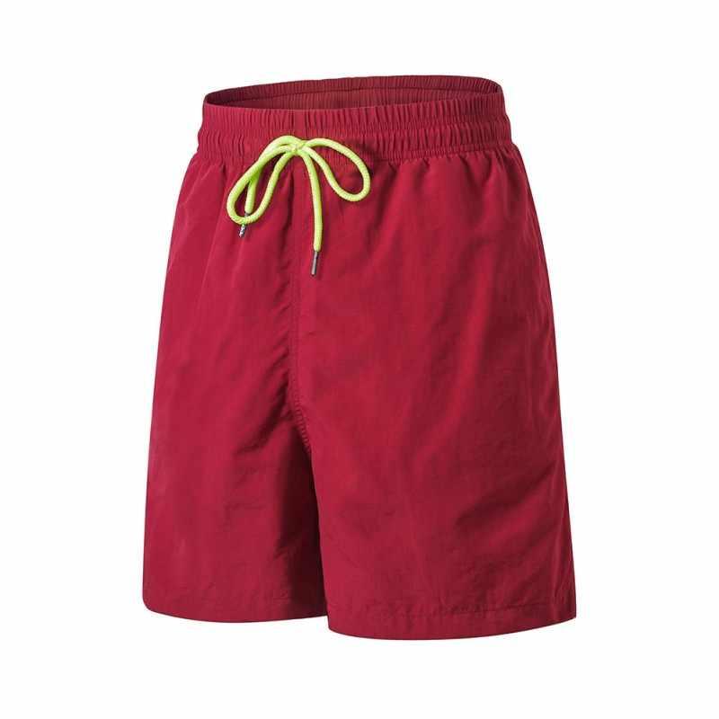 Los hombres shorts deportivos para exterior de verano playa estilo Casual pantalones de Fitness corriendo de secado rápido pantalones cortos