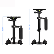 Get more info on the 60CM Aluminum Handheld S60 Camera Stabilizer for Video Camcorder Canon/Nikon/Sony/Minolta/Pentax/Olympus/Nissin/Sigma/Metz