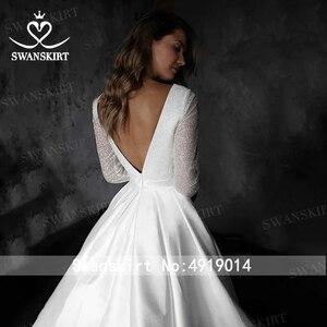 Image 2 - Prachtige Satijn Trouwjurk Swanskirt HZ32 Eenvoudige V hals Lange Mouw A lijn Prinses Bruidsjurk Aangepaste Vestido De Novia