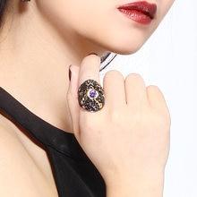 Женские вечерние кольца большие черные широкие с фиолетовыми