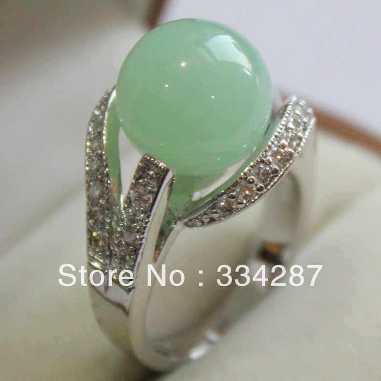 + + + جميل الضوء الأخضر حجر 12 مللي متر حبة الأبيض الزركون خاتم المرأة المجوهرات هدية