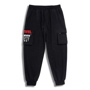 Image 4 - בתוספת גודל 7xl 6xl 5xl מכנסיים מטען גברים מוצק צבע שחור Loose מקרית Jogger כיס אלסטי מותניים קרסול אורך מכנסיים