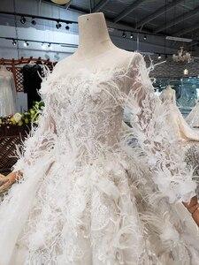 Image 5 - Bgw HT4304 特別ウェディングドレスと羽のためのシースルーバック手作りボタンブライダルドレス vestido デ noiva プリンセサ