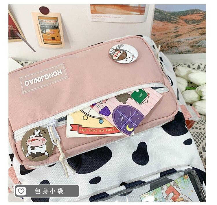 Vaca mochila para o estudante feminino sacos