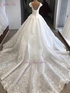 Image 2 - ג וליה Kui מתוקה מחשוף יוקרה כדור שמלת חתונת שמלה עם עדין אפליקציות מכתף