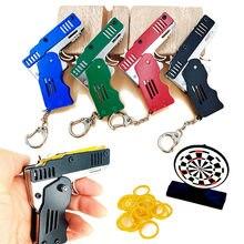 Brinquedo da arma da faixa de borracha todo o metal mini pode ser dobrado como uma arma do anel chave brinquedo do presente das crianças seis explosões do brinquedo de borracha liga de zinco