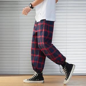 Image 1 - 2020 新メンズスウェットパンツ男性のパンツチェック柄ストリートジョギング男性コットン混紡ヒップホップランナーズボンドロップ無料 ABZ216
