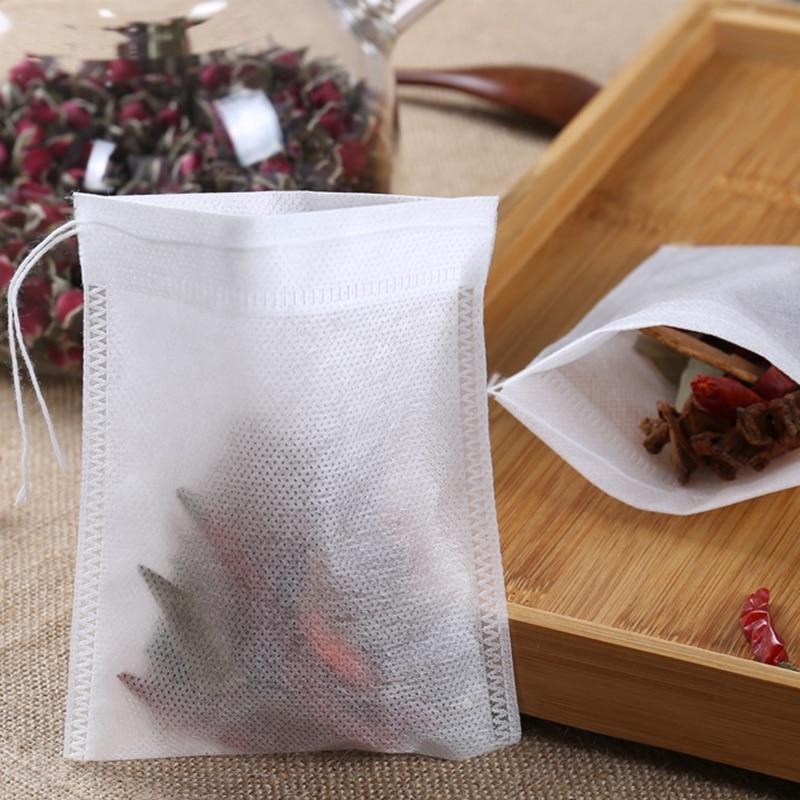 100 stücke 5X7cm Einweg Kordelzug Teebeutel Leer Tee Taschen für Tee Tasche Lebensmittel Grade Non-woven Stoff Papier Kaffee filter Teegeschirr