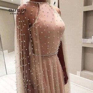 Image 2 - を oucui 高級イリュージョンピンク真珠オープンバックイブニングパーティードレスロング 2020 ホルターチュール a ラインウエディングドレスと岬 OL103546