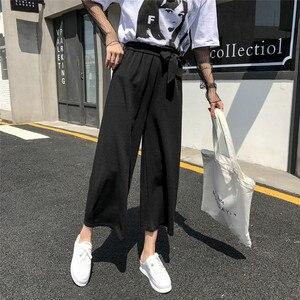 Image 4 - Женские свободные брюки палаццо, Элегантные повседневные брюки в стиле преппи с широкими штанинами, однотонные брюки, 2020