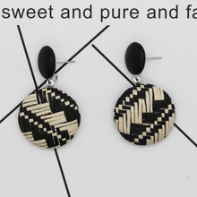 New earrings bohemian style retro button earrings National style woven straw paper round earrings new hand woven u shaped earrings exaggerate bohemian hollowed out tassels and national wind earrings