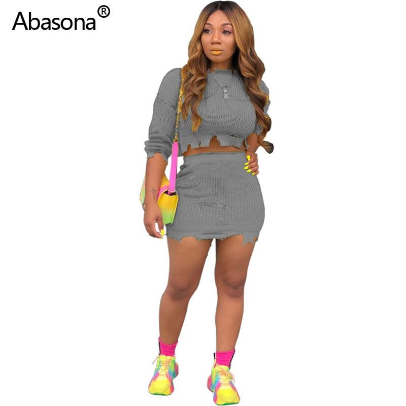 2019 nouveau solide o-cou pull tricoté trou Crop Tee Top Mini jupes avec taille élastique deux pièces ensemble Skinny Club robe tenue