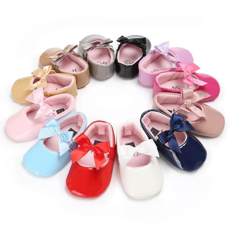 Offre spéciale bébé fille chaussures belle nœud en cuir 12 chaussures de couleur anti-dérapant baskets semelle souple enfant en bas âge chaussures 0-12 mois livraison directe