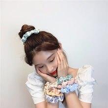E versão coreana do novo verão round dot stripe daisy grande intestino círculo menina bonito versátil curl cabeça jóias