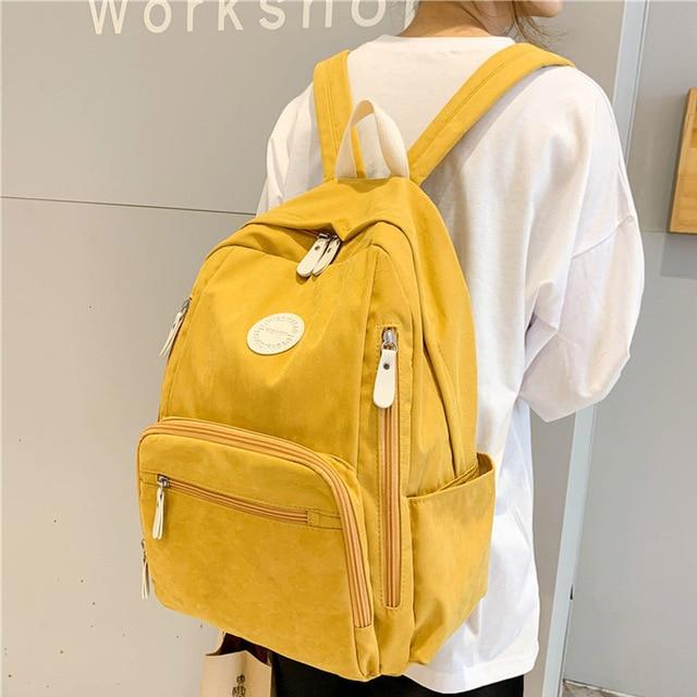 حقيبة ظهر نسائية جديدة مصنوعة من النايلون ذات جودة عالية حقيبة مدرسية بلون واحد للفتيات المراهقات حقائب ظهر للسفر بتصميم أنيق كتاب Preppy Mochila