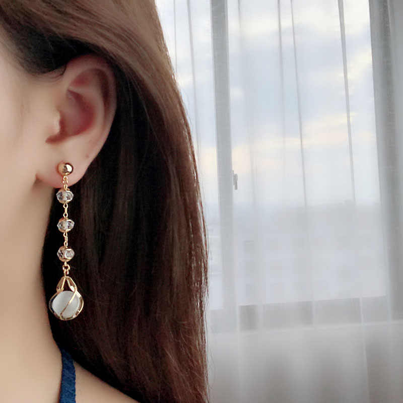 Simple gouttes d'eau sauvage oreille ongles longues boucles d'oreilles femme 925 japonais et coréen rétro cristal long gland Ins Style élégant tendance