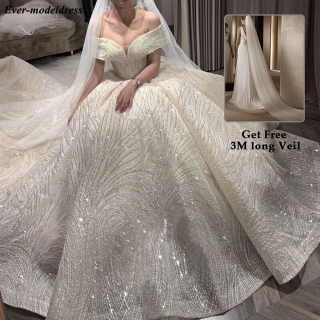 Luxury Wedding Dresses 2021 Off Shoulder African Sparkly V-Neck Lace Up Back Ball Gown Court Train Bridal Robe Do Mariee 1