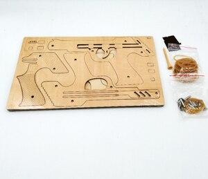 Image 3 - Laser Schneiden DIY 3D Holz Puzzle Holzhandwerk Montage Kit 9 Laufschuhe Feuer Gummiband Pistole Für Kind Geschenk (mit 50 + gummi bands)