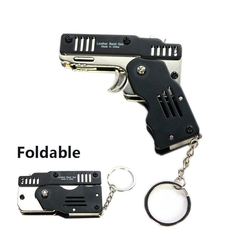 Mini Folding Sechs Platzt Gummiband Pistole Kann Halten Die Schlüssel Kette Maß Alle Metall Pistolen Schießen Spielzeug Geschenke Jungen outdoor werkzeuge geschenk