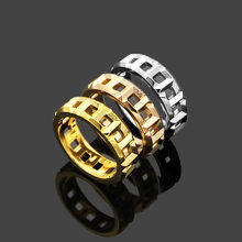 Titanium steel jewelry T-letter hollow ring lovers foreign trade type hollow t-ring men and women pair ring(China)