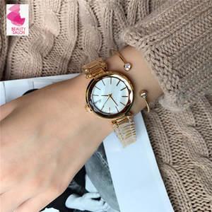 good quality fashion dress quartz watch for lady round dial women wristwatch sports