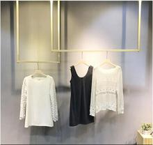Clothing store display rack hanger gold ceiling hanging women's clothing store display rack wall clothing rack