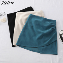 HELIAR Solid Irregular Skirt Hem A Line Micro Beach Skirt Preppy Style Skirt With Pleated High Waist Skirt For Women 2020 Summer