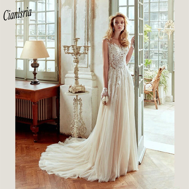 Gorgeous Champagne Illusion Top Country Wedding Dress Cap Sleeve Boat Neck Appliques Lace Long Bridal Wedding Dresses