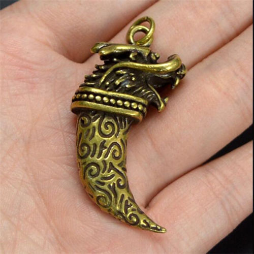Chinese Brass Dragon Head Wolf Tooth Exquisite Small Pendant Statues