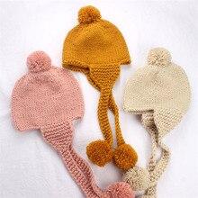 Chapéu quente bonito da malha do inverno da cor sólida 2020 com earflap e pompons para meninos e meninas 2-5years 46-51cm