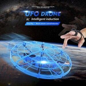 Image 2 - طائرة صغيرة بدون طيار UFO بدون طيار مع كاميرا إيماءة الجاذبية التعريفي طائرات بدون طيار كوادكوبتر المضادة للتصادم ماجيك اليد UFO الكرة الطائرات لعبة أطفال