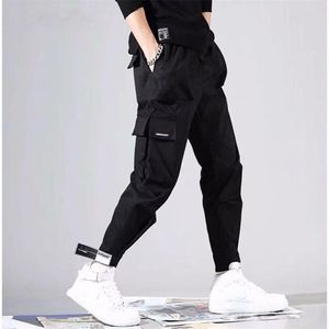 Image 3 - Erkek yan cepler Harem pantolon 2020 sonbahar Hip Hop rahat şerit tasarım erkek Joggers pantolon moda Streetwear pantolon siyah