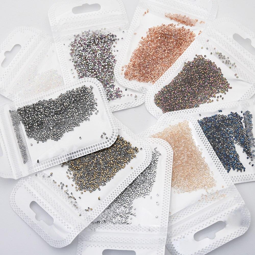 1440 adet/torba 9 renkler mikro boncuk kristal tırnak sanat Rhinestones 1.3mm Culet elmas cam Glitter çıtçıt AB taş süslemeleri # JR74