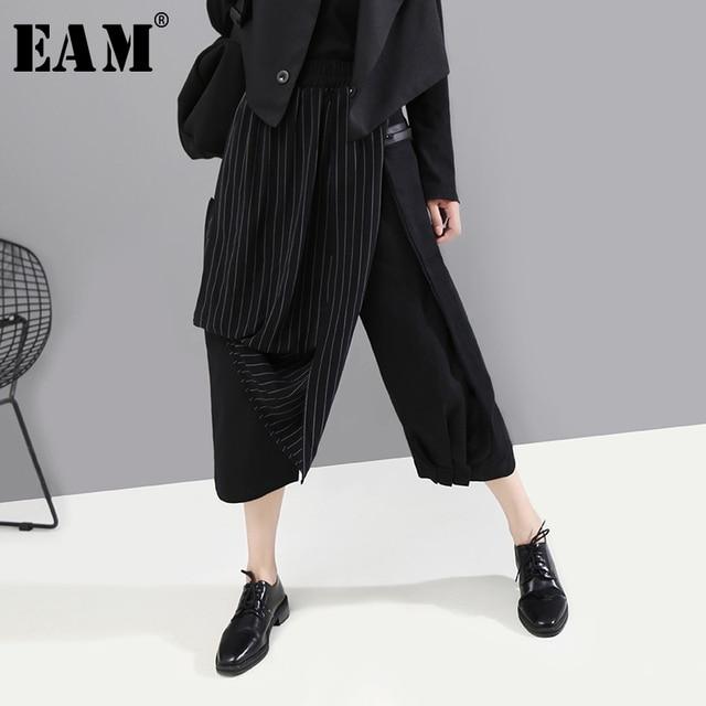 [EAM] عالية مرونة الخصر مخطط أسود غير المتماثلة بنطلون جديد فضفاض صالح السراويل النساء الموضة المد ربيع الخريف 2020 1A933
