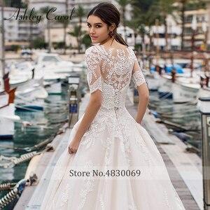 Image 4 - Ashley Carol A Line Wedding Dresses With Jacket 2020 Vestido De Noiva Beach Half Sleeve Appliques Lace Up Button Bridal Gowns