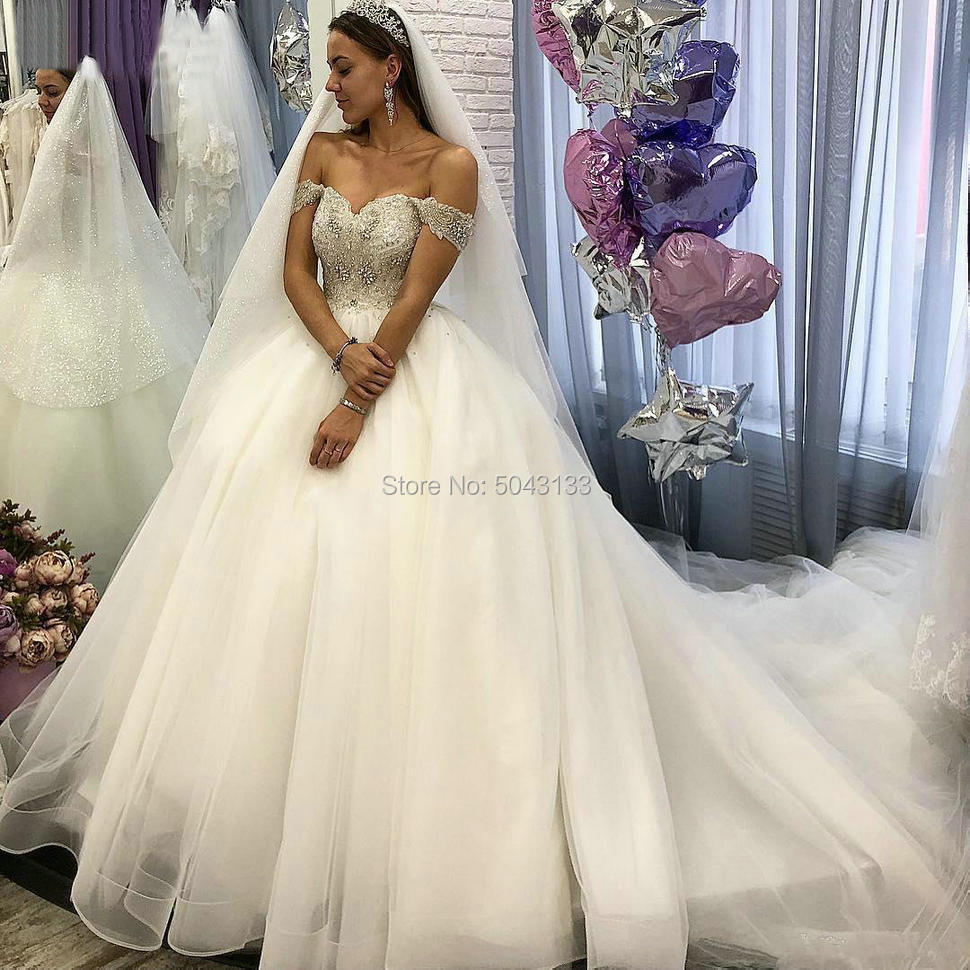 Luxury Beads Ball Gown Wedding Dresses 2020 Sexy Sweetheart Off Shoulder Tulle Bridal Gown Crystals Cap Sleeve Ivory Bride Dress