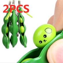2 pçs diversão brinquedos ervilhas feijão brinquedos pingentes stressball engraçado engenhocas squishy natal fidget brinquedos squishy espremer anti estresse