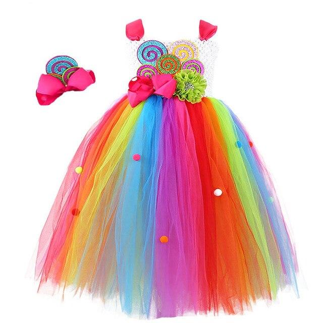 زي عيد ميلاد للبنات مصنوع من الحلوى على شكل قوس قزح للأطفال فستان منتفخ بفيونكة على شكل زهرة وطوق رأس مناسب لحفلات أعياد الميلاد