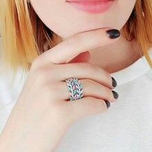 Женское кольцо с синим и розовым цирконием ювелирное изделие