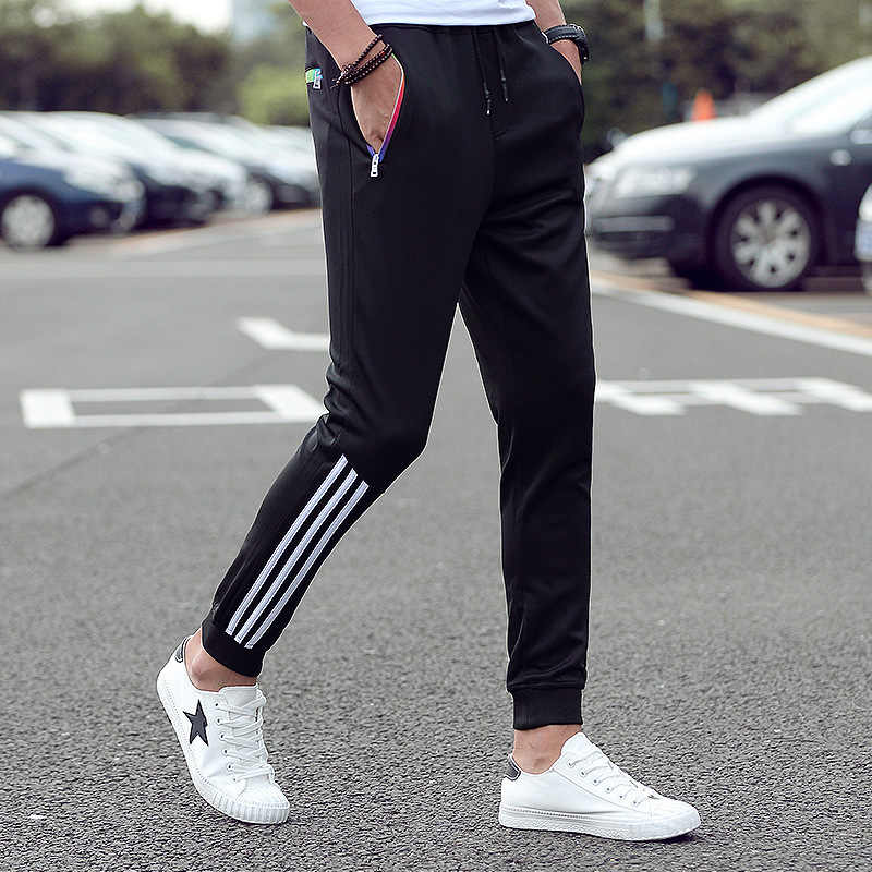 Pantalones de hombre a rayas Jogger otoño Casual Hombre pantalones de chándal ropa deportiva pantalones largos nuevos 2019 Pantalones rectos Hombre Ropa de Fitness 5XL