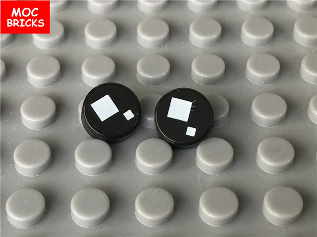 LEGO® White Tile Round 1 x 1 with Black Eye with Pupil Squinting Pattern