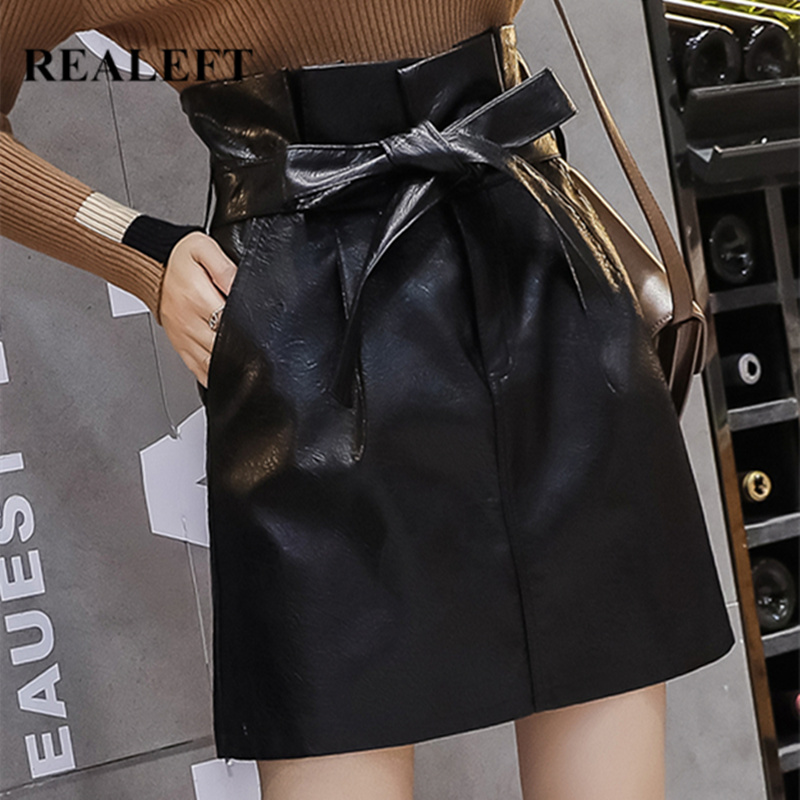REALEFT Autumn Winter Black Mini Skirts High Waist PU Leather Wrap Sexy A-Line Bow Skirts With Belt Pocket Office Lady 2019