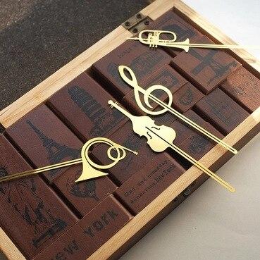 ¡Novedad! Bonitos instrumentos musicales Kawaii dorados, marcapáginas de Metal Marcadores de libro para libros, Clips de papel, material de papelería para oficina y escuela