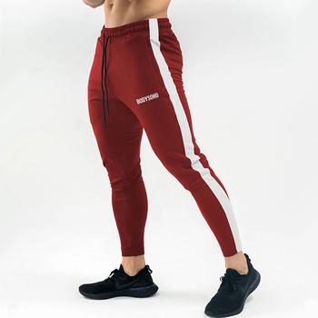 Dorywczo spodnie obcisłe męskie spodnie dresowe dla joggerów siłownie Fitness Workout spodnie do biegania męskie kulturystyka spodnie bawełniane 2020 nowa odzież sportowa tanie i dobre opinie GLOBESKY Na co dzień Sznurek Mieszkanie Pełnej długości Poliester COTTON skinny 28 - 40 Patchwork Sweatpants for men