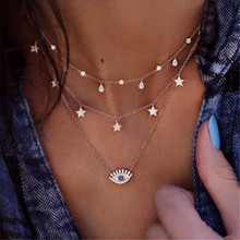 цена на Free Shipping Multilayer Crystal Eye Pendant Choker Necklace Women Crystal Star Water Drop Tassel Beads Chain Pendnats Necklaces