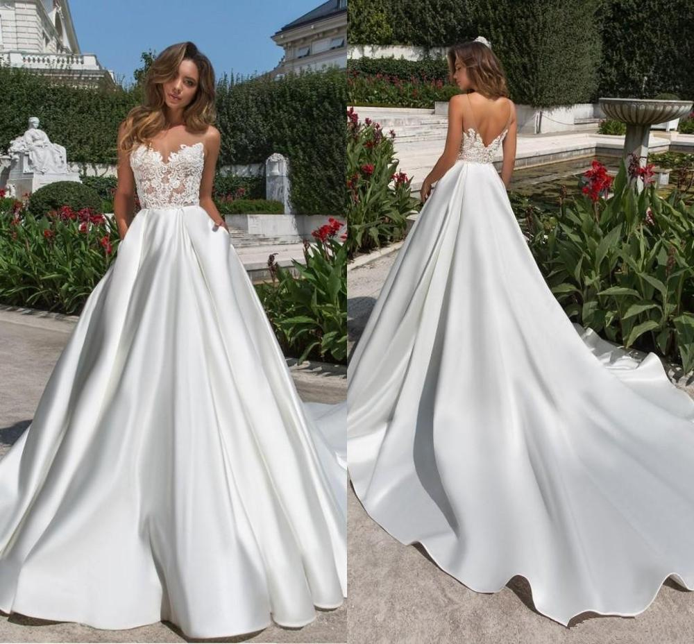 2020 Newest Design A Line Satin Wedding Dreses Modest Sheer Neck V Cut Backless Bridal Gown With Pockets Lace Long Train