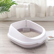 Litter box with scoop