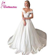Свадебное платье с блестками аппликацией и открытыми плечами