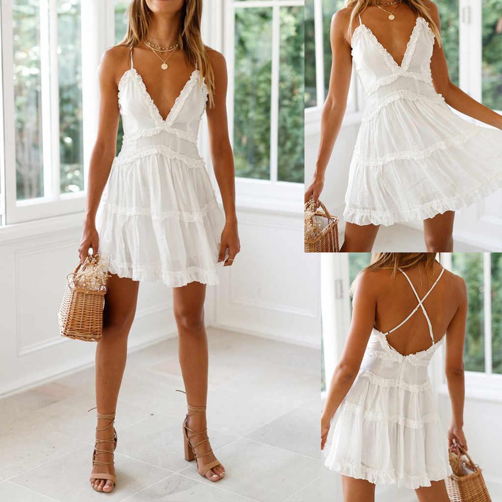 Yaz kadın dantel elbise seksi Backless v yaka plaj elbise 2020 moda kolsuz spagetti kayışı beyaz rahat Mini Sundress